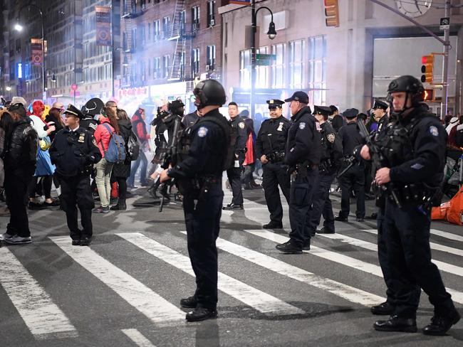 NYPD officers stand guard during the 44th annual Halloween Parade in New York. Picture: AFP