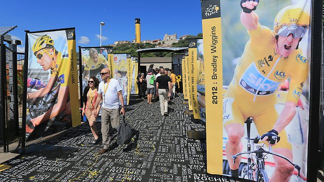 Spectators are seen walking through an exhibition of winners of the race from previous years before the start of stage one of the 2013 Tour de France, a 213KM road stage from Porto-Vecchio to Bastia, on June 29, 2013 in Porto Vecchio, France.