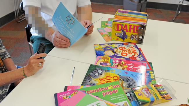 The inmates have a great selection of books to choose from, and also design their own CD covers. Picture: Joe Castro