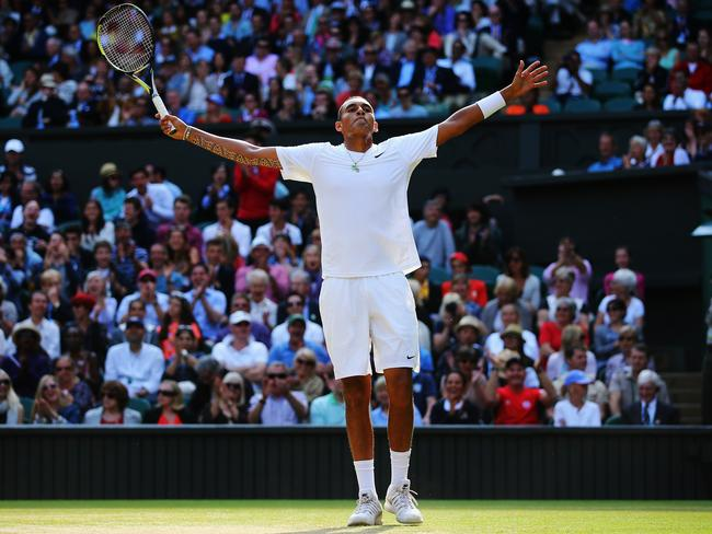 Nick Kyrgios celebrates during his shock victory over Rafael Nadal at Wimbledon.