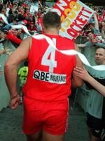 Footballer Tony Lockett leaving oval celebrating kicking 1300th goal breaking the 62 year old record of Gordon/Coventry. AFL football - Collingwood vs Sydney Swans match at SCG 06 Jun 1999.