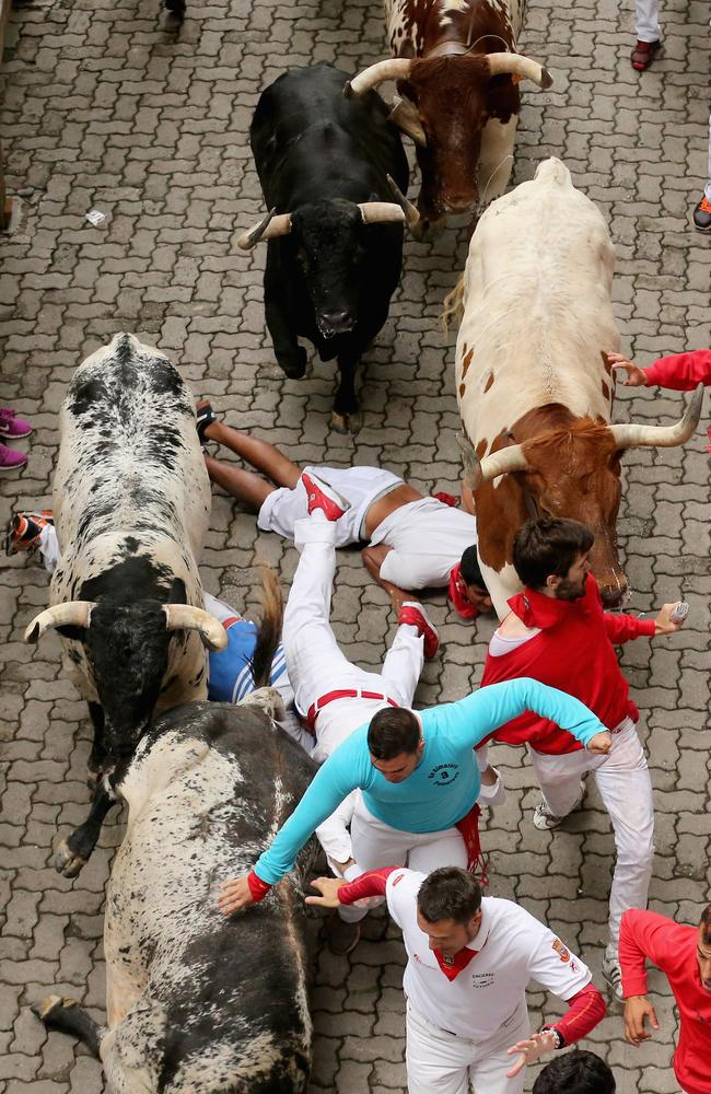Show no fear ... one person was gored and four others injured on day one of the running of the bulls festival in Pamplona.