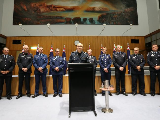 Victorian Chief Commissioner Ken Lay addresses a gathering of Australian And New Zealand Police Commissioners and MPs on the eve of White Ribbon Day, at Parliament House, Canberra.