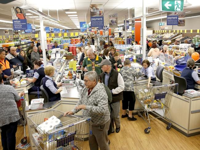 What a nightmare … Shoppers queue up at Aldi, Campbelltown. Picture: Luke Fuda
