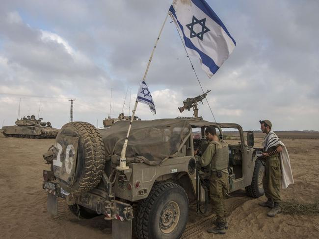 Line of defence ... Israeli soldiers patrol the Gaza border. Picture: AFP
