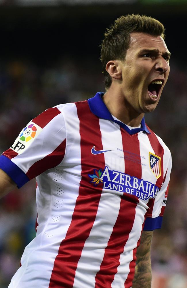 Atletico Madrid's Croatian forward Mario Mandzukic celebrates after scoring.
