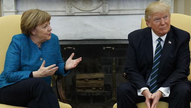 President Donald Trump reportedly handed German Chancellor Angela Merkel the invoice during their meeting at the White House. Picture: Evan Vucci/AP Photo