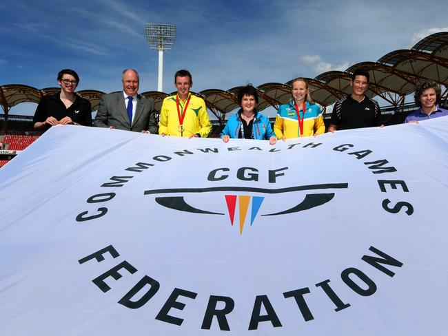 Jann Stuckey (fourth from left), Minister for Tourism, Major Events and Small Business, Mark Peters (second from left), CEO, Gold Coast 2018 Commonwealth Games with athletes Jake Duffy (left), Michael Shelley, Melanie Schlanger, Wesley Caulkett and Wade Townsend during the unveiling of the games flag at Metricon Stadium in Carrara, Gold Coast / Picture: Regi Varghese