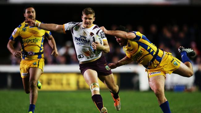 Brisbane's Dale Copley is tackled by Manly's Josh Starling.