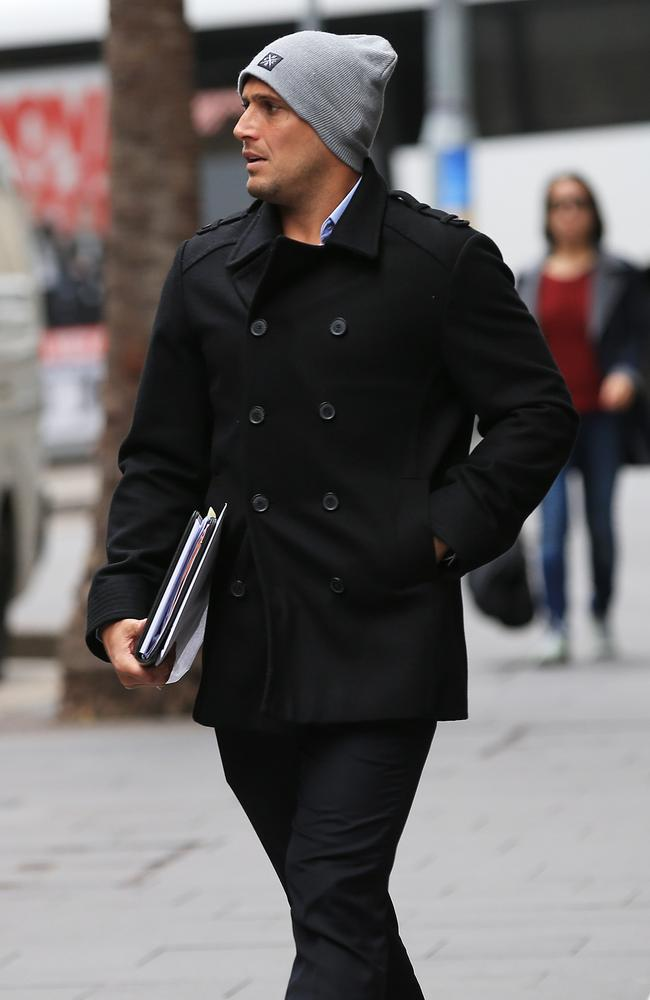 Former Cronulla Sharks player Jeremy Smith leaves his lawyer's office in Sydney after meetings regarding the ASADA issue.