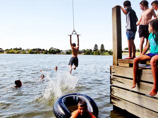 Kids cool down in Lake Nagambie where temperatures peaked just over 40 degrees today.