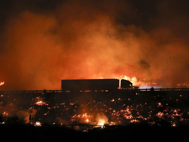 A truck drives along the 101 Freeway as a wildfire continues to burn. Picture: AP
