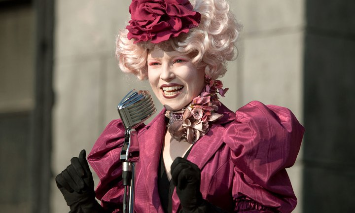 EFFIE: Effie Trinket is the District 12 Escort with a flamboyant sense of style played to perfection by Elizabeth Banks. In the old days, Effie was the short form of Euphemia, but it can certainly stand on its own now.