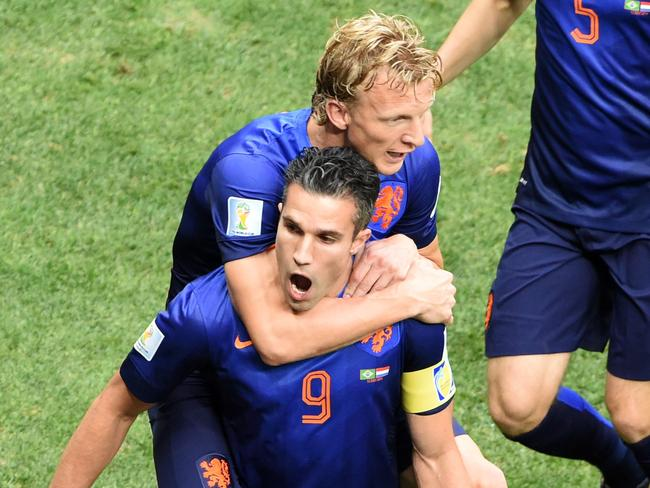 Netherlands forward and captain Robin van Persie celebrates after scoring the opening goal of the 2014 World Cup third place playoff against Brazil.