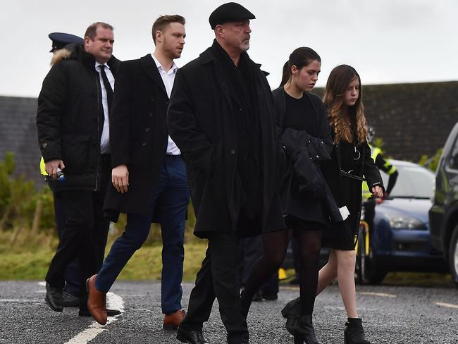 Dolores O'Riordan's ex-husband Don Burton and their children Taylor, Molly and Dakota Burton arrive at the service. Picture: Charles McQuillan/Getty Images