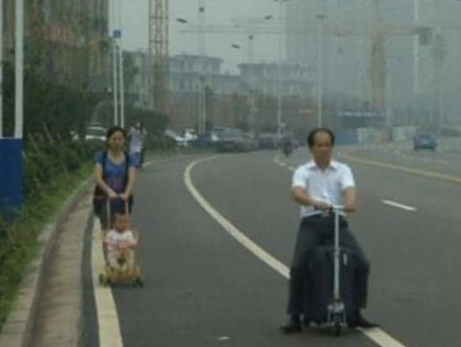 Easy rider ... Mr Liangcai turns heads on the streets of Changsha City.