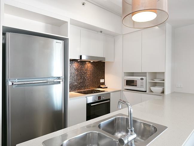 The apartment has a modern kitchen, and two bathrooms. Picture: Experience Realty.