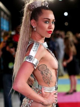 Cyrus shows off her dreamcatcher tattoo at the MTV Music Video Awards in 2015. Picture: Christopher Polk/Getty Images