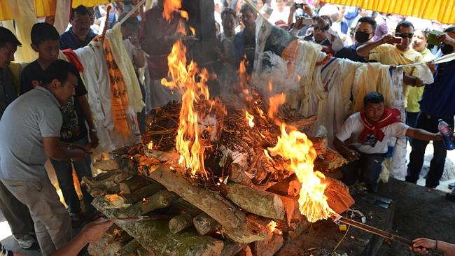 Last rites ... family members perform final rituals at the funeral pyre of a Mount Everest avalanche victim in Kathmandu. Picture: AFP