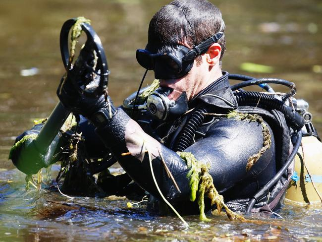 Water Police and Army divers searched wetlands at Sandgate in relation to the murder in April this year. Picture: AAP