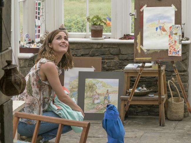 Bea (Rose Byrne) with a Peter Rabbit stand-in on the set of Peter Rabbit.