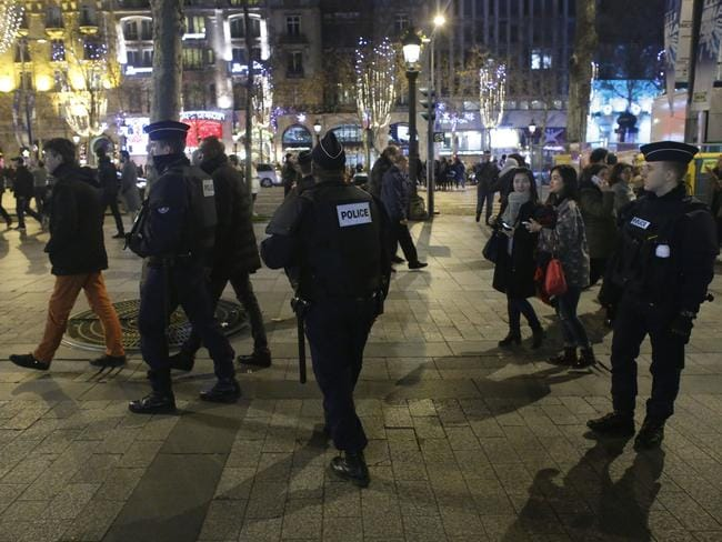 French gendarmes patrol Paris on New Year's Eve.