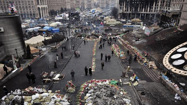 Revolution...People walk on Kiev's Independence square on February 25, where weeks of vio