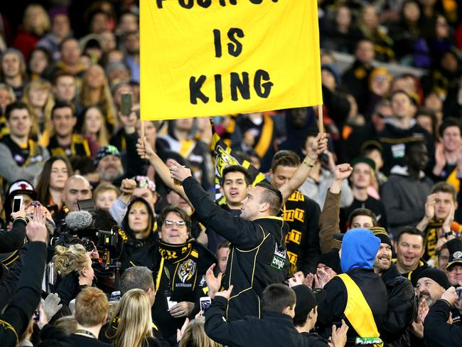 Jake King has a beer with the cheer squad. Picture: Tim Carrafa