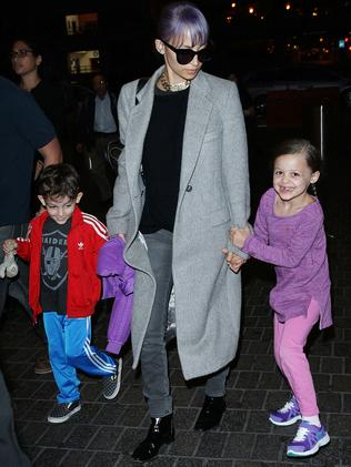 Happy family ... Nicole Richie and kids arriving at Los Angeles International Airport. Picture: Splash News