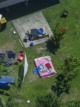 A mattress and clothing are strewn across the backyard of the house. Picture: Brian Cassey