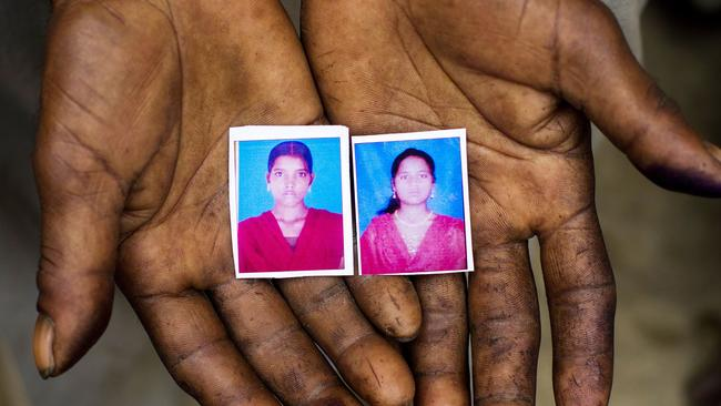 Innocence lost ... photographs of murdered gang rape victims Pushpa, left, and Murti are held by Murti's father Sohan Lal.