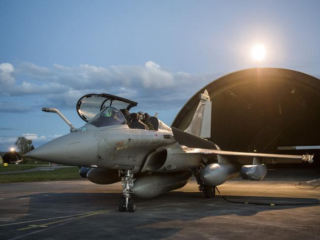 A Dassault Rafale fighter aircraft is prepared for air strikes in Syria at Saint Dizier air base, eastern France. Picture: French Defense Ministry/ECPAD via AP