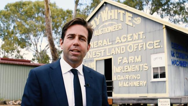 """Brian White's son Dan, a director at Ray White, in front of the original office. Ray's son Alan White remembers the shed as a place """"always busy with people either wanting to buy, exchange or sell everything imaginable, including farm machinery, cars and livestock"""". The family later moved to Brisbane to focus on real estate."""