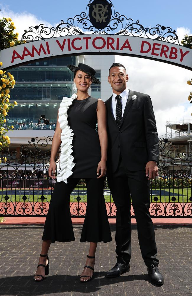 Maria Tutaia and Israel Folau pose on Derby Day at Flemington Racecourse. Picture: Mark Metcalfe/Getty Images