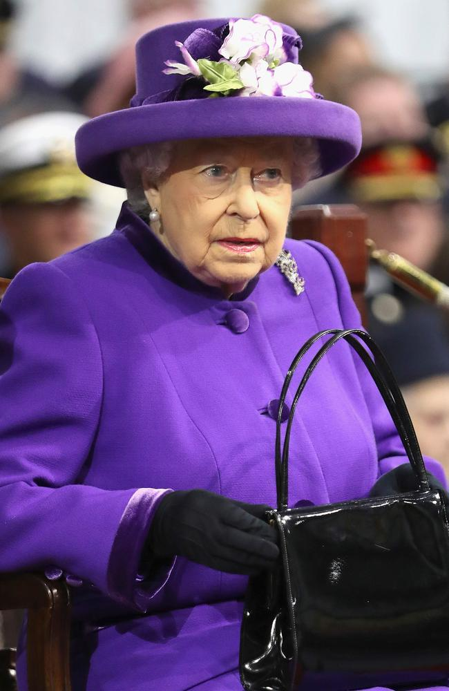 Queen Elizabeth II uses her handbag to convey signals to staff. Putting it on the table at dinner means she wants the event to end and putting it on the floor is a sign to her ladies in waiting to rescue her. Picture: AFP Photo/Pool/Chris Jackson