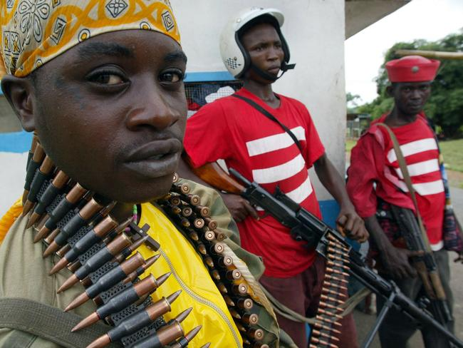 Shoot on sight for illegal crossings of border ... Liberian military forces stand guard.