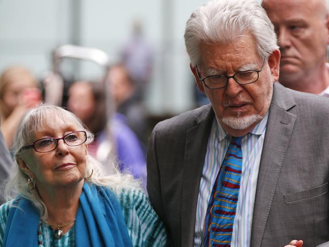 His support ... Rolf Harris, centre, accompanied by wife Alwen, at the Southwark Crown Court in London. Picture: Lefteris Pitarakis