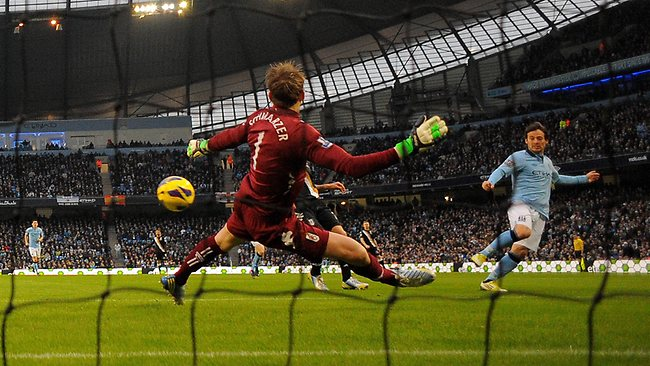 Manchester City's Spanish midfielder David Silva puts the ball past Fulham's Aussie keeper Mark Schwarzer.