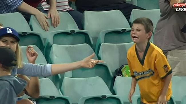 It's his...Fans point to the little boy as he screams for the ball.