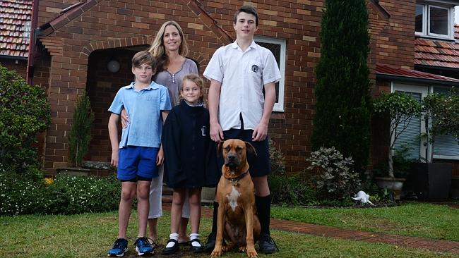 Michelle Richter with children Connor Wicks 14, Brandon Wicks 10, and Sienna Wicks 7, and the family dog Dante.