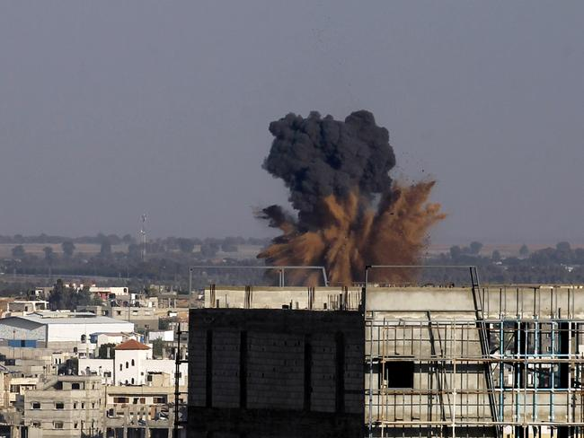 Truce ends ... an Israeli air strike in Rafah in the southern of Gaza strip. Israel ordered its negotiators back from talks in Cairo and warplanes hit Gaza after Palestinian rockets smashed into the south as the two sides were observing a 24-hour truce. Picture: AFP PHOTO / SAID KHATIB