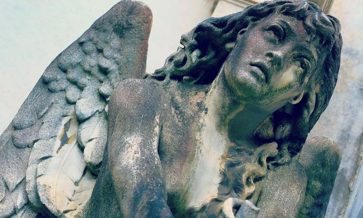 Young sad Angel looking to sky, Recoleta cemetery, Buenos Aires
