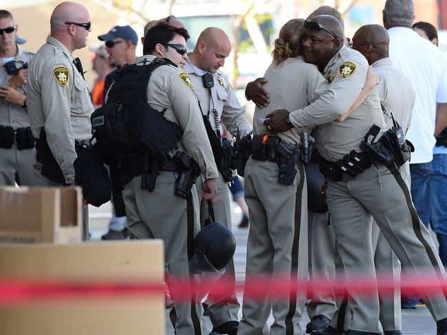 Las Vegas Metropolitan Police Department officers hug near the Walmart where two of their colleagues were shot dead. Picture: Getty Images/AFP