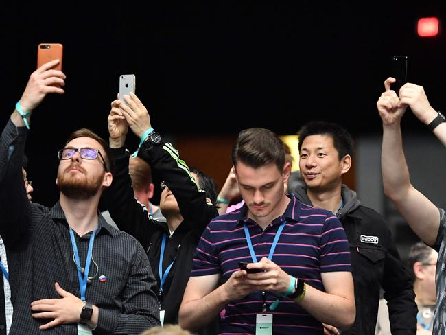 Attendees take photos at San Jose McEnery Convention Center during Apple's Worldwide Developers Conference. Picture: Josh Edelson/AFP