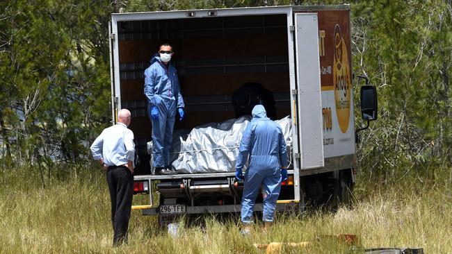 Police load the metal box into a van after pulling it out of the dam. Picture: AAP Image/Dan Peled
