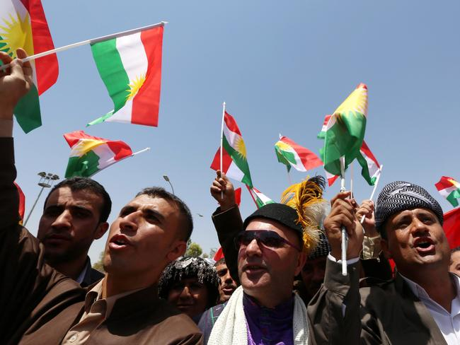 Referendum sought ... protesters in favour of independence wave the flag of the autonomous Kurdistan region, outside the Kurdistan parliament building in Arbil, northern Iraq. Picture: Safin Hamed