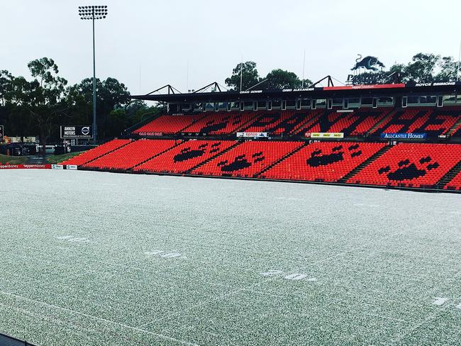 Penrith stadium covered by a white coating of hail.