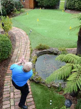 Peter Mann plays a round in his backyard, where British golfer Tom Lewis holds the seven-under par record, along with Peter's son Geoffrey.