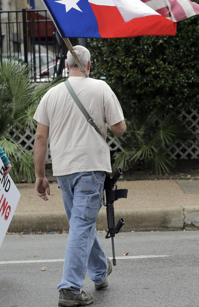 Yep, Americans can legally walk around like this. Picture: AP Photo/Eric Gay