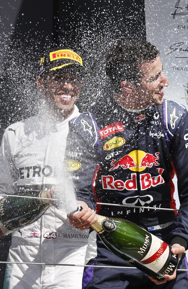 Ricciardo celebrates with Lewis Hamilton in the background. Picture: AP